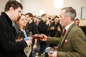Whisky Birmingham festival - Exhibitor pours a glass for a visiting couple